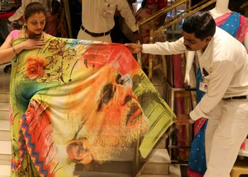 Modi saree hits market before parliamentary elections, way to attract female voters